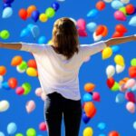 woman standing in the midst of balloon live life to the fullest quotes