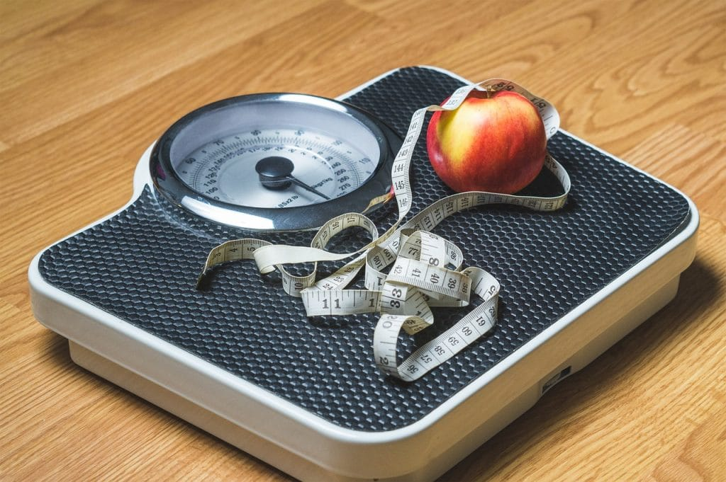 a scale with an apple and measuring tape best weight loss quotes