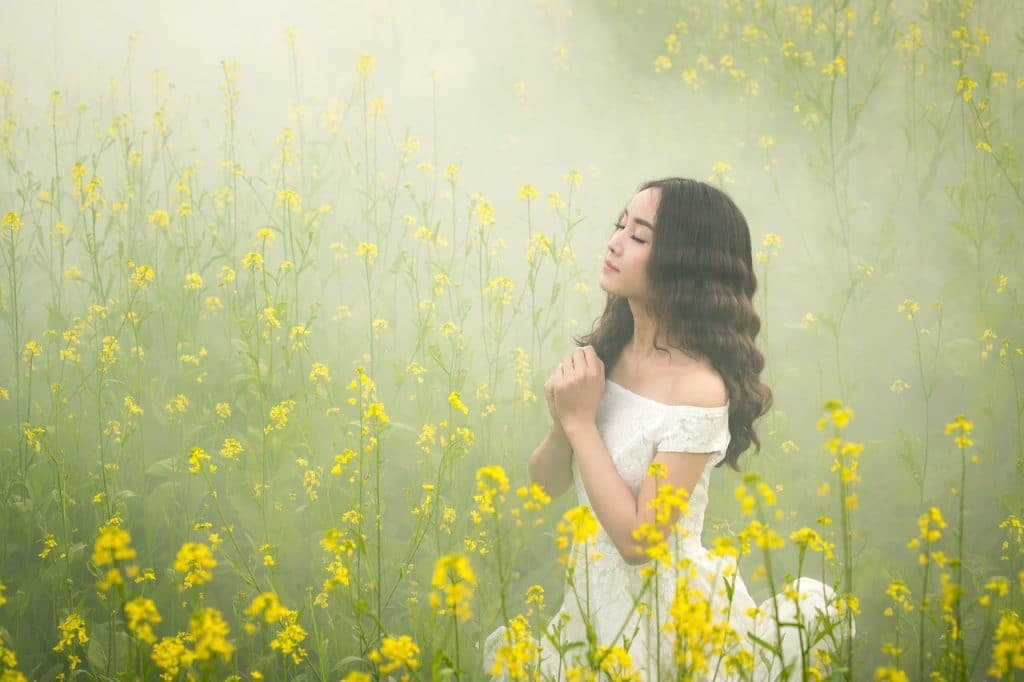 girl in a field of yellow flowers quotes about gratitude