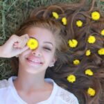 girl laying with yellow flowers in her hair inspirational quotes for teens