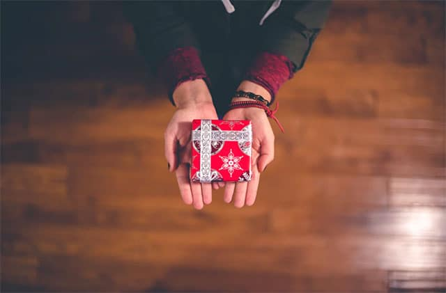 Person holding a small gift