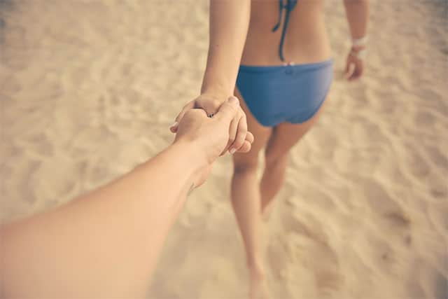 Two person holding hands