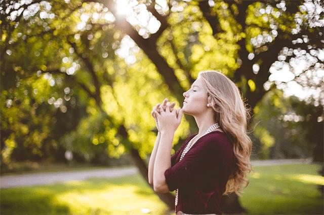 Woman praying outdoor