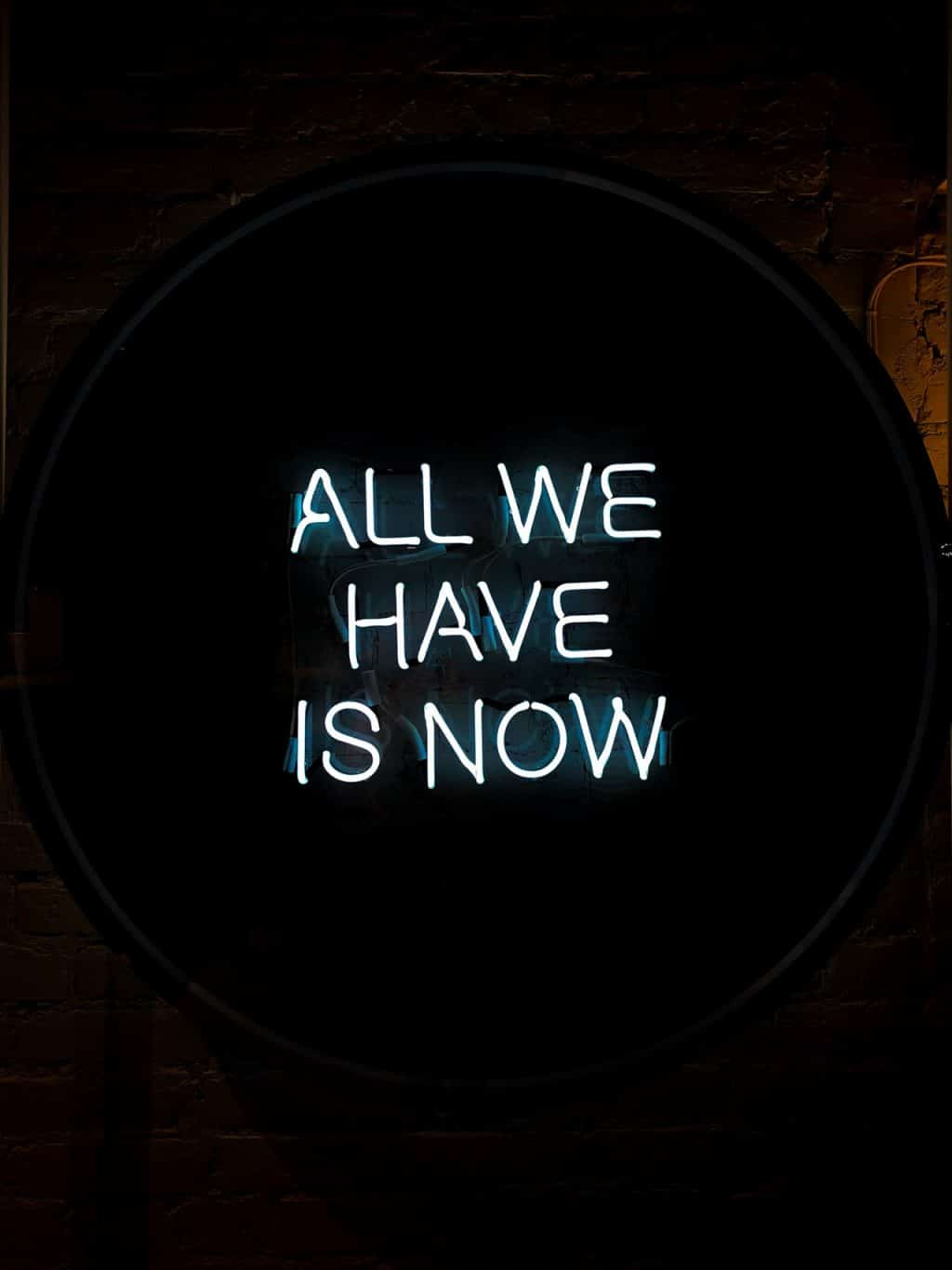 all we have is now quote on black background
