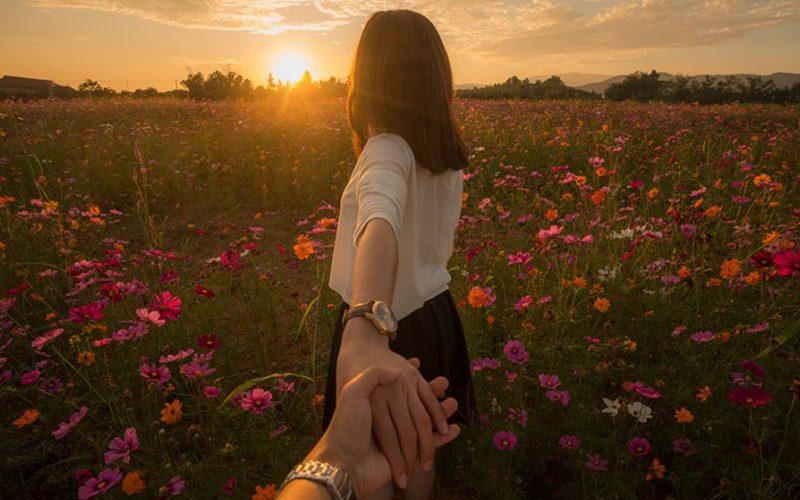 girl holding hand of lover