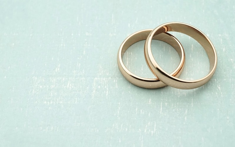 wedding rings placed on top of each other