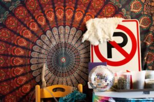 room displays and tapestry on wall