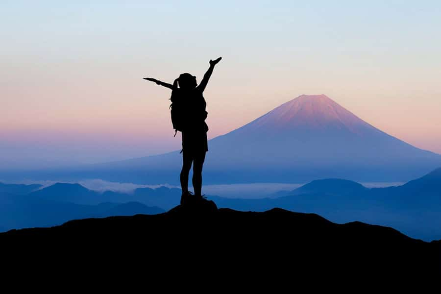 woman declare success on top of the mountain