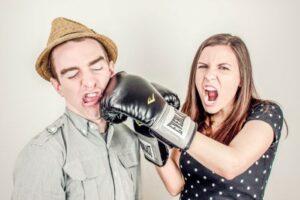 woman punching a man